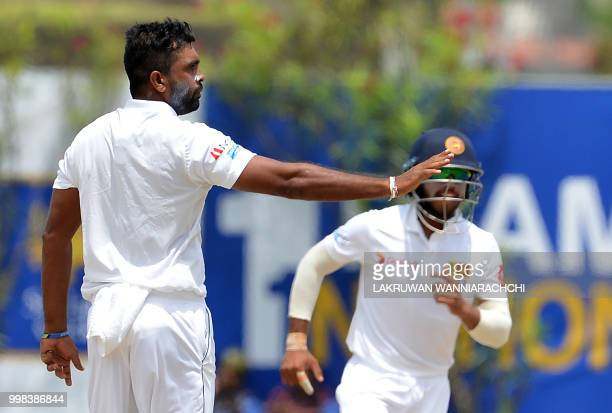 Sri Lanka's Dilruwan Perera celebrates after he dismissed South Africa's Dean Elgar during the third day of the opening Test match between Sri Lanka...