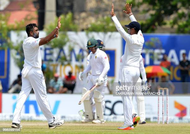 Sri Lanka's Dilruwan Perera celebrates with his teammates after he dismissed South Africa's Quinton de Kock during the third day of the opening Test...
