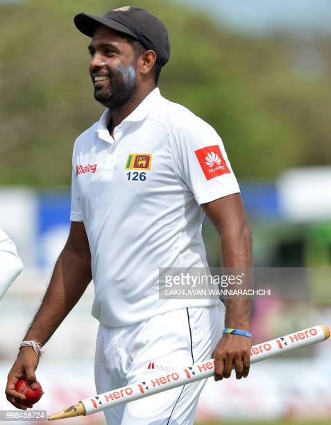 Sri Lanka's Dilruwan Perera leaves the ground with the stumps after victory in the opening Test match between Sri Lanka and South Africa at the Galle...