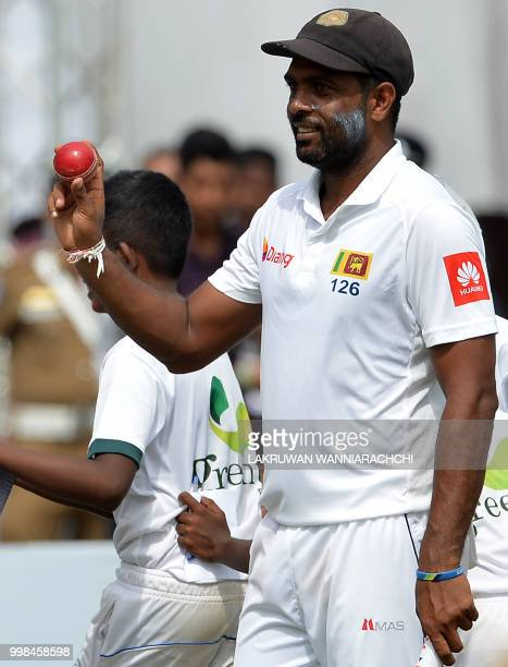 Sri Lanka's Dilruwan Perera shows the ball as he celebrates taking six wickets after victory in the opening Test match between Sri Lanka and South...