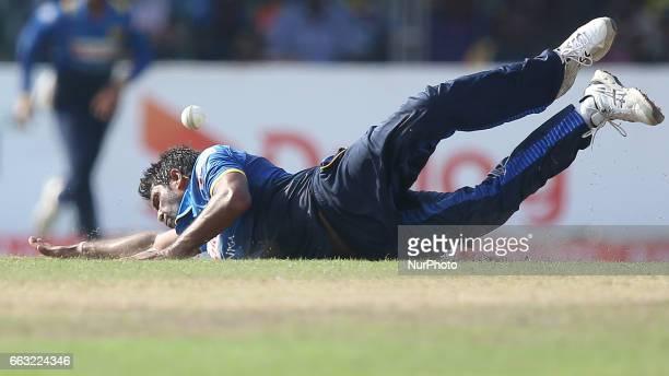 Sri Lanka's Dilruwan Perera tries to stop a ball during the third oneday international cricket match between Sri Lanka amp Bangladesh at SSC in...
