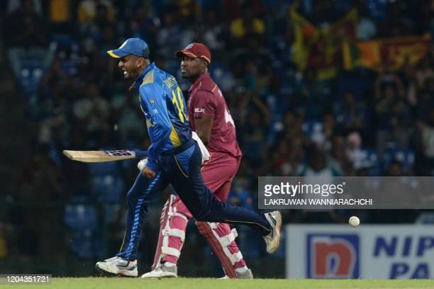 Sri Lanka's Dimuth Karunaratne celebrates after dismissing West Indies Darren Bravo during the third one day international cricket match between Sri...
