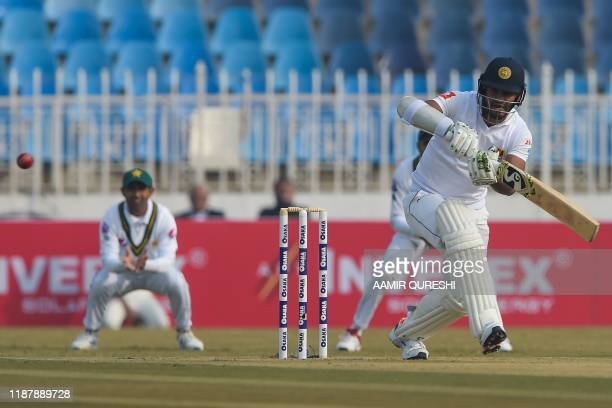 Sri Lanka's Dimuth Karunaratne plays a shot during the first day of the first Test cricket match between Pakistan and Sri Lanka at the Pindi Cricket...