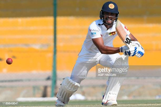 Sri Lanka's Dinesh Chandimal plays a shot during the second day of the second Test cricket match between Pakistan and Sri Lanka at the National...