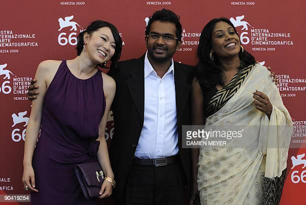 "Sri Lanka's director Vimukhti Jayasundara is flanked by actress Kaushalya Fernando and Chinese actress Hang Lu during the photocall of ""Ahasin Wetei""..."
