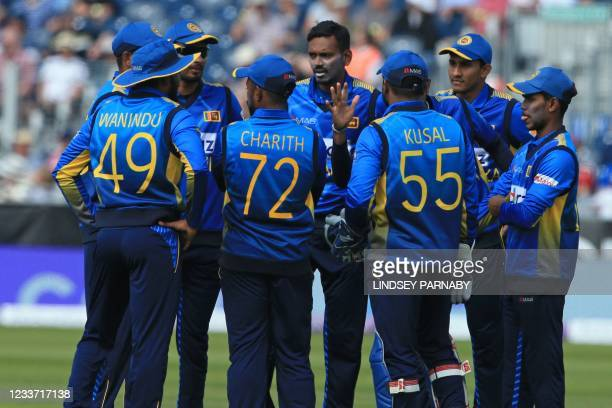 Sri Lanka's Dushmantha Chameera celebrates with teammates after taking the wicket of England's Captain Eoin Morgan during the first one-day...