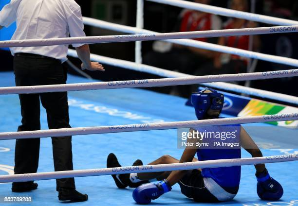 Sri Lanka's Erandi de Silva on the canvas against England's Nicola Adams in the Women's Fly Quarterfinal 4 at the SECC during the 2014 Commonwealth...