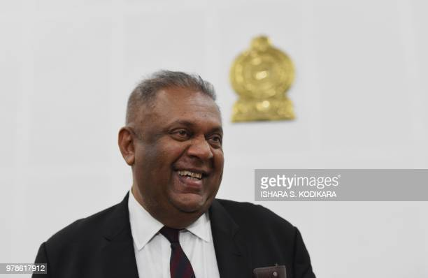 Sri Lanka's Finance Minister Mangala Samaraweera addresses a press conference to announce a 15% value added tax removal on doctors' consultation fees...