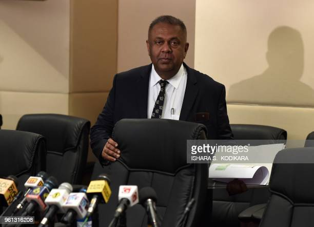 Sri Lankas Finance Minister Mangala Samaraweera arrives at a press conference in Colombo on May 22 to warn of the country's increasing foreign debt...