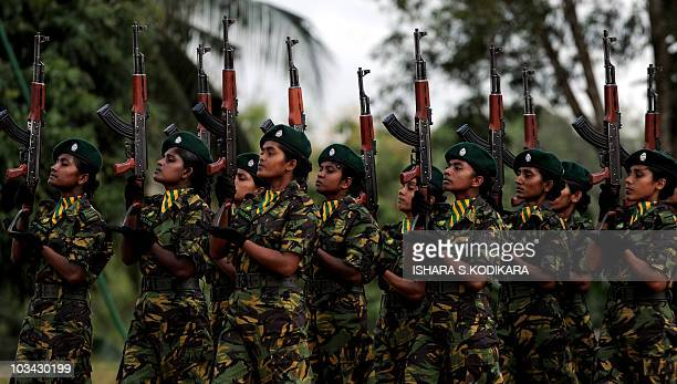 Sri Lanka's first batch of Police Special Task Force women commandos march during a passing out parade at Katukurunda some 40 kms south of Colombo on...