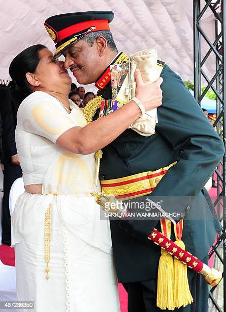 Sri Lankas first field marshal Sarath Fonseka is kissed by his wife Anoma Fonseka at a ceremony in Colombo where President Maithripala Sirisena...