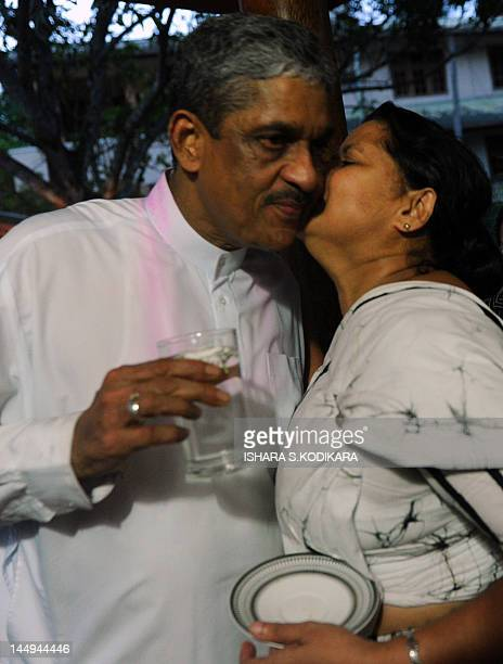 Sri Lanka's former army chief Sarath Fonseka is kissed by his wide Anoma following Fonseka's release from prison at their residence in Colombo on May...