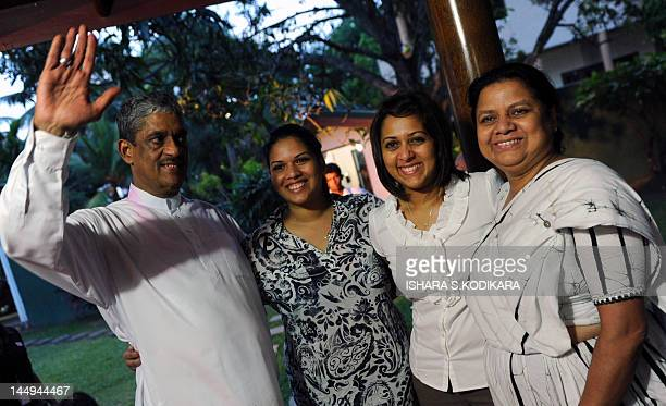 Sri Lanka's former army chief Sarath Fonseka poses with his wife Anoma and daughters Aparna and Apsara following Fonseka's release from prison at...