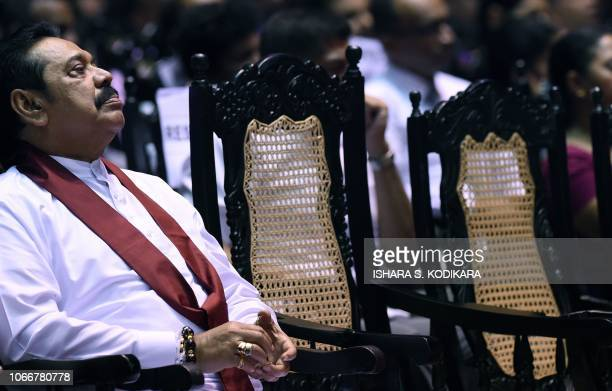 Sri Lankas former president and currently appointed Prime Minister Mahinda Rajapaksa looks on during a ceremony granting employment to social service...