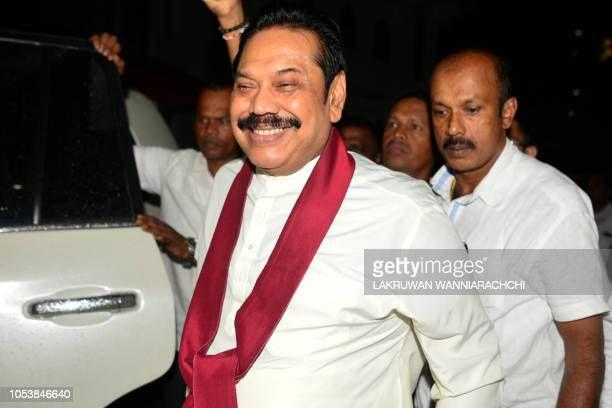 Sri Lanka's former president and new prime minister Mahinda Rajapaksa arrives at a temple after having been sworn in as prime minister in Colombo on...