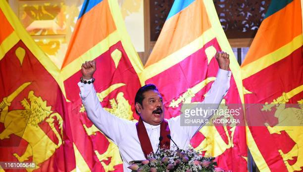 Sri Lanka's former president Mahinda Rajapaksa gestures durign a speech after his brother and former defense secretary was nominated as a...