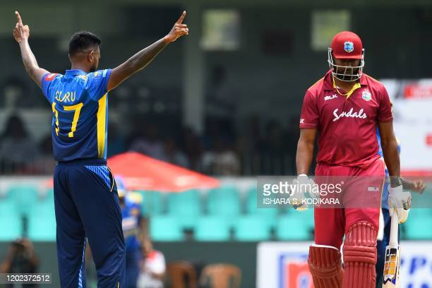 Sri Lanka's Isuru Udana celebrates after dismissing West Indies' captain Kieron Pollard during the first one day international cricket match between...