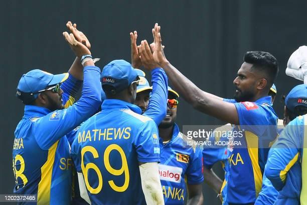 Sri Lanka's Isuru Udana celebrates with teammates after dismissing West Indies' captain Kieron Pollard during the first one day international cricket...