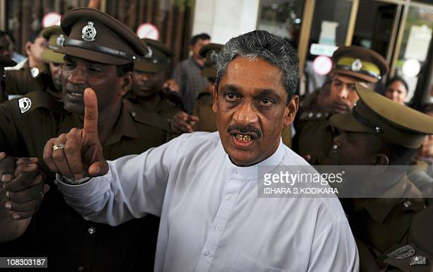 Sri Lanka's jailed ex-army chief and opposition leader Sarath Fonseka gestures as he arrives at the Court of Colombo on January 25, 2011. Fonseka...