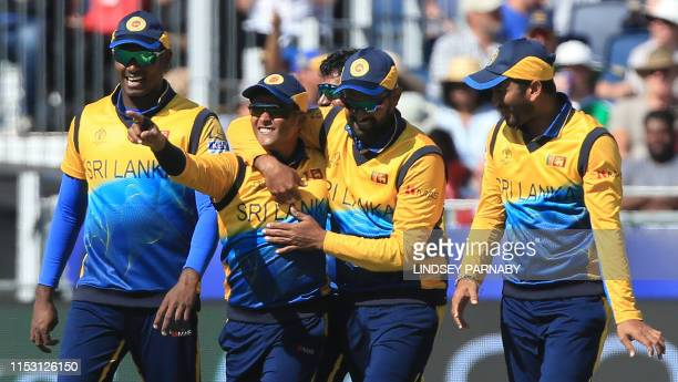 Sri Lanka's Jeffrey Vandersay celebrates with teammates after taking a catch to dismiss West Indies' Chris Gayle during the 2019 Cricket World Cup...