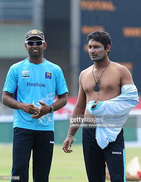 Sri Lanka's Kumar Sangakkara and Tharanga Paranawethana look on during a practice session at the Galle International Stadium in Galle on March 24...