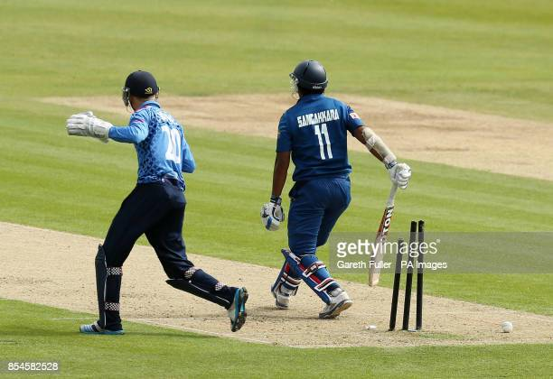 Sri Lanka's Kumar Sangakkara loses his wicket to Adam Ball watched by wicket keeper Sam Billings during the tour match at The Spitfire Ground Kent