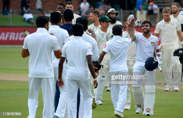 Sri Lanka's Kusal Mendis greets teammates after victory on the third day of the second Test cricket match between South Africa and Sri Lanka at St...