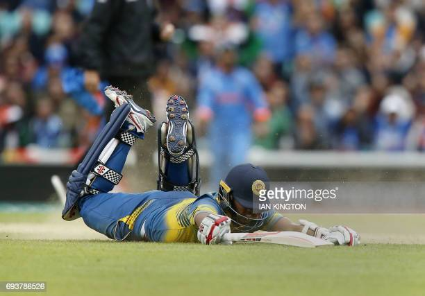 Sri Lankas Kusal Mendis is run out by Indias Bhuvneshwar Kumar for 89 runs during the ICC Champions Trophy match between India and Sri Lanka at The...
