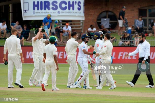 Sri Lanka's Kusal Mendis shakes hands with South African players after matching SA's score to win by 8 wickets on the third day of the second Test...