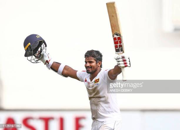 Sri Lanka's Kusal Perera celebrates the victory after hittting the winning runs during the fourth day of the first Cricket Test between South Africa...
