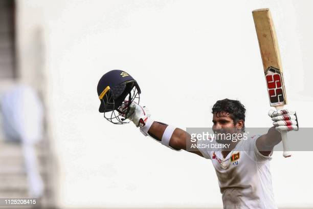 Sri Lanka's Kusal Perera celebrates the victory after hittting the winning runs of a South Africa's player during the fourth day of the first Cricket...