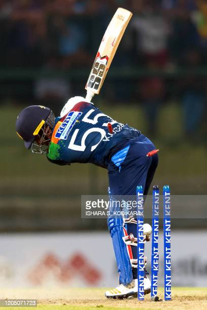 Sri Lanka's Kusal Perera is bowled out by West Indies' Andre Russell during the first Twenty20 international cricket match of a twomatch series...