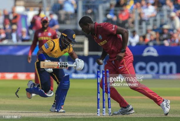 TOPSHOT Sri Lanka's Kusal Perera is run out by West Indies' Carlos Brathwaite during the 2019 Cricket World Cup group stage match between Sri Lanka...
