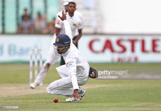 Sri Lanka's Lahiru Thirimanne drops a catch at silly point during the third day of the first Cricket Test between South Africa and Sri Lanka at the...