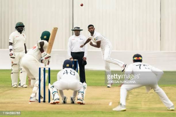 Sri Lanka's Lasith Embuldeniya delivers a ball to Zimbabwe's Kevin Kasuza as Zimbabwe's Prince Masvaure Sri Lanka's Niroshan Dickwella and umpire...