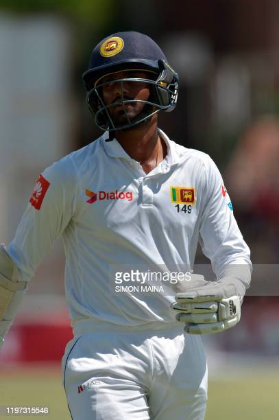 Sri Lanka's Lasith Embuldeniya walks back to the pavilion after his dismissal by Zimbabwe's Sikandar Raza during the third day of the second Test...