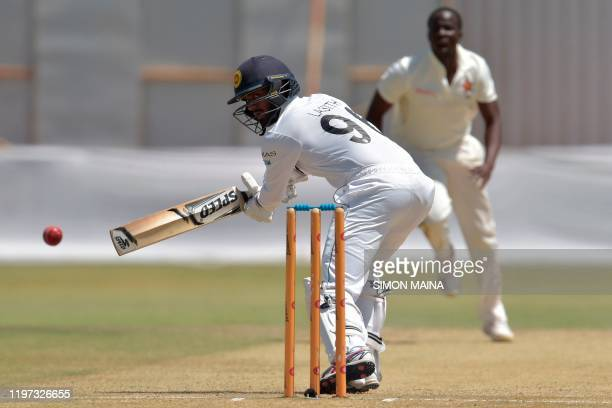 Sri Lanka's Lasith Embuldeniya watches the ball after playing a shot delivered by Zimbabwe's Donald Tiripano during the third day of the second Test...