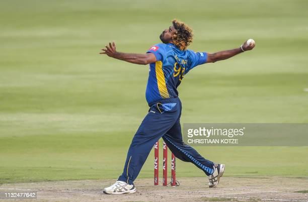 Sri Lanka's Lasith Malinga bowls during the third Twenty20 international cricket match between South Africa and Sri Lanka at the Wanderers Stadium in...
