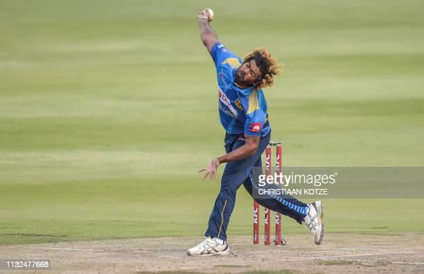 TOPSHOT Sri Lanka's Lasith Malinga bowls during the third Twenty20 international cricket match between South Africa and Sri Lanka at the Wanderers...