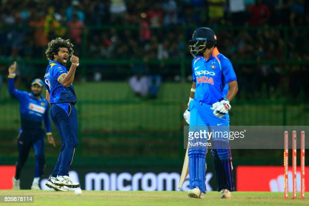 Sri Lanka's Lasith Malinga celebrates aftertaking the wicket of India's Shikhar Dhawan during the 3rd One Day International cricket match between Sri...