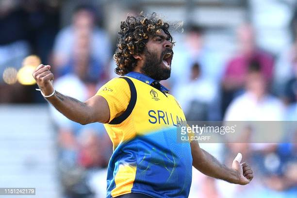 Sri Lanka's Lasith Malinga celebrates taking the wicket of England's Jos Buttler for 10 runs during the 2019 Cricket World Cup group stage match...