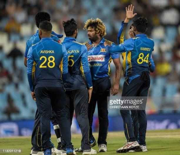 Sri Lanka's Lasith Malinga celebrates with his teammates after getting a wicket during the second Twenty20 international cricket match between South...