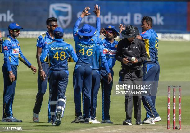 Sri Lanka's Lasith Malinga celebrates with teammates after catching out South Africa's Aiden Markram during the third Twenty20 international cricket...