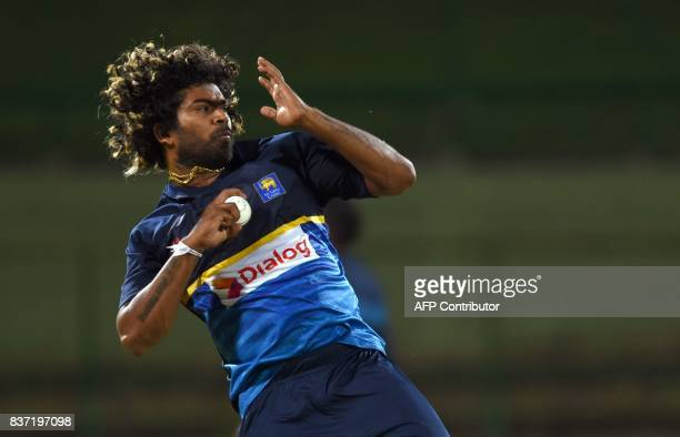 Sri Lanka's Lasith Malinga delivers the ball during a practice at the Pallekele International Cricket Stadium in Pallekele on August 22 ahead of the...