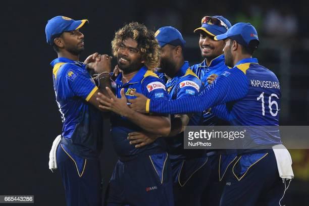 Sri Lanka's Lasith Malinga second left celebrates taking the hat trick wicket dismissing Bangladeshi batsman Mehedi Hasan Miraz with teammates during...