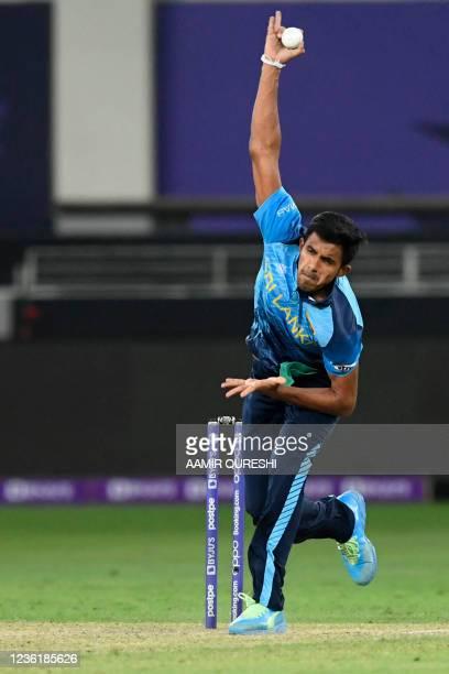 Sri Lanka's Maheesh Theekshana delivers a ball during the ICC mens Twenty20 World Cup cricket match between Australia and Sri Lanka at the Dubai...