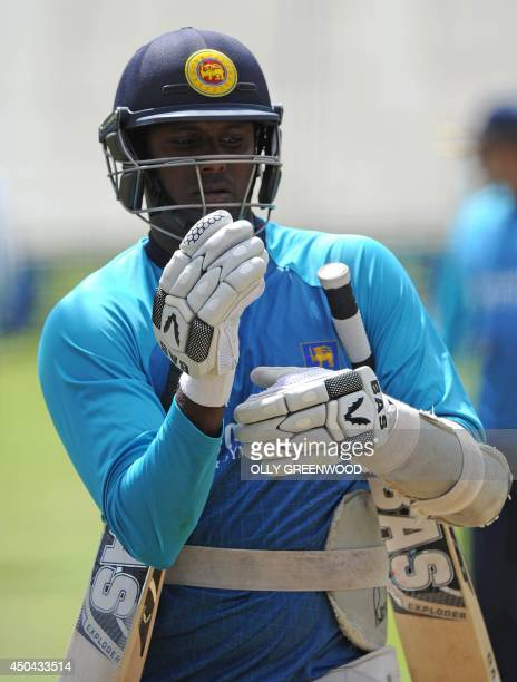 Sri Lankas Mahela Jayawardena attends a practice session at Lords cricket ground in London on June 11, 2014 ahead of the first Test match between...