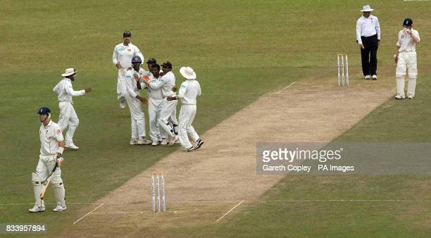 Sri Lanka's Muttiah Muralitharan celebrates dismissing England's Kevin Pietersen during the First Test at the Asgiriya International Stadium Kandy...
