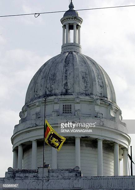 Sri Lanka's national Lion flag flies at half mast at the Town Council Hall in Colombo 15 August 2005 ahead of foreign minister Lakshman Kadirgamar's...