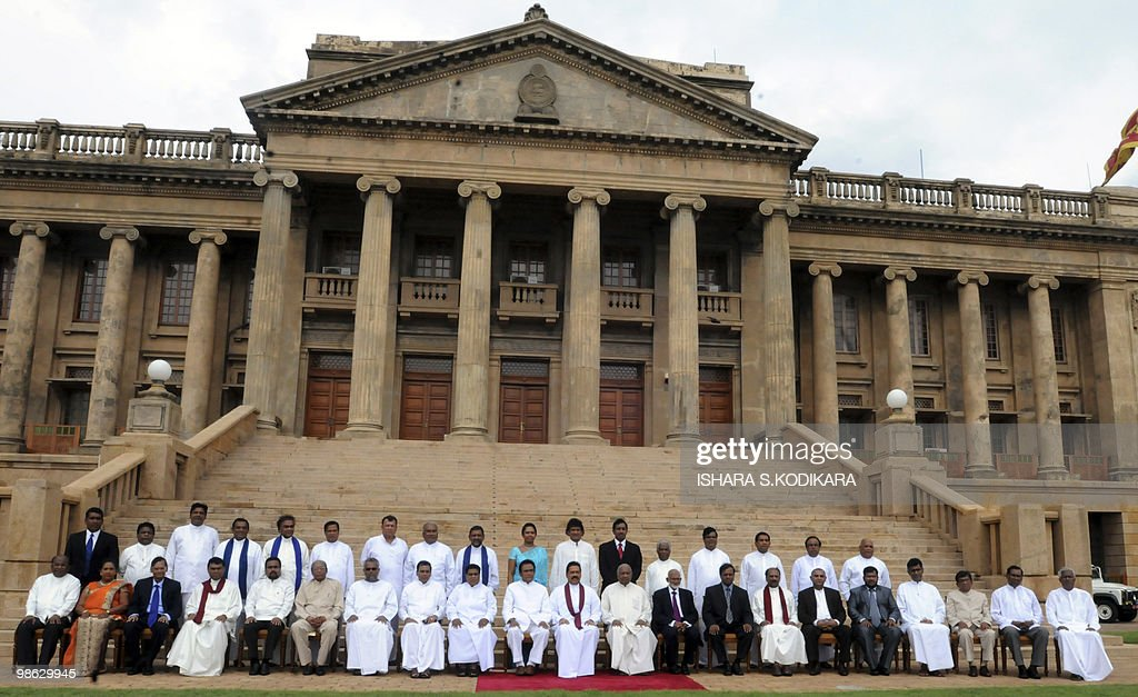Sri Lanka's new cabinet ministers pose for a group photo in Colombo on April 23, 2010. Sri Lanka's new Cabinet was sworn in by Sri Lankan President Mahinda Rajapakse folowing his parliamentary election win on April 8. AFP PHOTO/ Ishara S